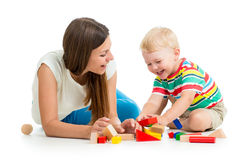 Kid playing toys together mother Stock Photos