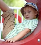 Kid playing in tunnel on playground Royalty Free Stock Photography