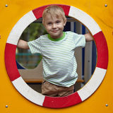 Kid playing in tunnel on playground Royalty Free Stock Photos