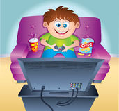 Kid Playing Video Game On Couch Stock Photography