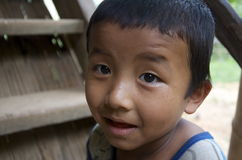 Kid playing in the village. Burma Stock Images