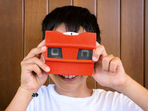 Kid playing with vintage 3d viewer Stock Images