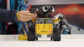 Kid playing with WALL-E. stock video