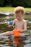 Kid playing in water Stock Photo