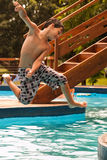 Kid jumping into the pool Stock Photography