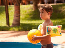 Kid playing volleyball at the pool Stock Images
