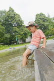 Kid playing with water Royalty Free Stock Photography