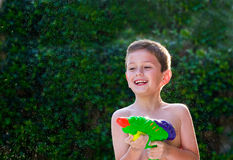 Kid playing with water toy. Royalty Free Stock Photography