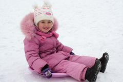 Kid playing in the winter Stock Image