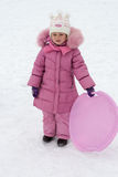 Kid playing in the winter Stock Images