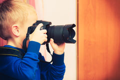 Free Kid Playing With Big Professional Digital Camera Stock Image - 93886431