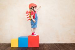 Free Kid Playing With Toy Rocket At Home Stock Photo - 143367230