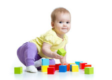 Kid playing wooden toy blocks isolated royalty free stock photos