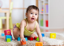 Kid playing  wooden toys Royalty Free Stock Image