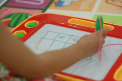 Kid playing write board toy Royalty Free Stock Photography