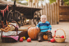 Kid playing in the yard of his house in the village Stock Photos