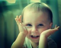 Kid plays blind eye handles. Royalty Free Stock Photography