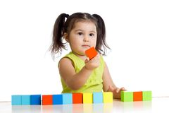 Kid plays with building blocks and learning of Stock Photography