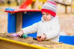 The kid plays cars on the street Royalty Free Stock Photography