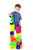 Kid plays with color blocks Stock Photos
