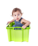 Kid plays with container. Kid plays with plastic container isolated on white stock photography