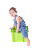 Kid plays with container. Kid plays with plastic container isolated on white royalty free stock photos