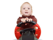 Kid plays a driving game console, isolated on white Stock Photo