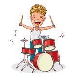 Kid plays the drums Stock Image