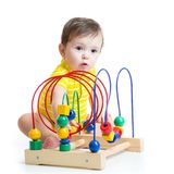 Kid plays with educational toy isolated Stock Photography
