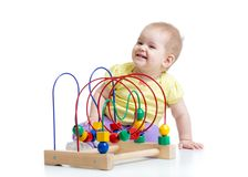 Kid plays with educational toy isolated Royalty Free Stock Photography
