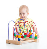 Kid plays with educational toy isolated royalty free stock photo