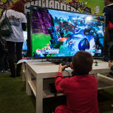Kid plays at Games Week 2013 in Milan, Italy Stock Photography
