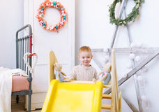 The kid plays in a nursery. Royalty Free Stock Images