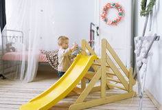 The kid plays in a nursery. Stock Images