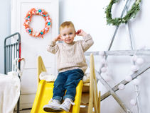 The kid plays in a nursery. Stock Image