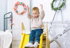 The kid plays in a nursery. Royalty Free Stock Photos