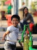 Kid plays the pump Stock Photos
