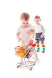 Kid plays in shop Stock Photo