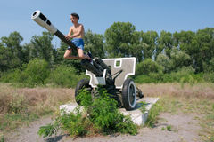 Kid plays on Soviet-times military monument Stock Images