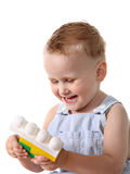 Kid plays with toy block Stock Image