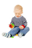 Kid plays with toys Stock Photography