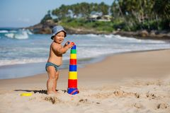 Kid plays with toys at the seashore in summertime Royalty Free Stock Photo