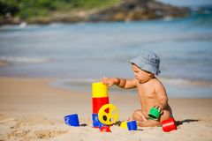 Kid plays with toys at the seashore in summertime Royalty Free Stock Photography
