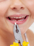 Kid with pliers holding a lost tooth - closeup Royalty Free Stock Photos
