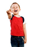 Kid pointing. Laughing boy isolated on the white background Stock Images
