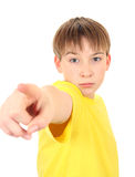 Kid Pointing. Serious Boy pointing Isolated on the White Background Stock Image