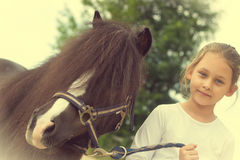 Kid and pony Royalty Free Stock Photography