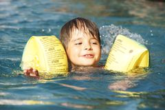 Kid in pool Royalty Free Stock Images