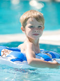 Kid on pool. Little kid on swimming pool Royalty Free Stock Photo