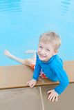 Kid at the pool Stock Images